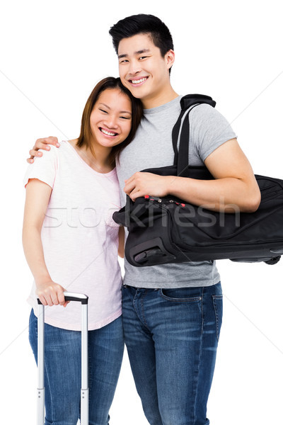 Young couple standing with luggage Stock photo © wavebreak_media