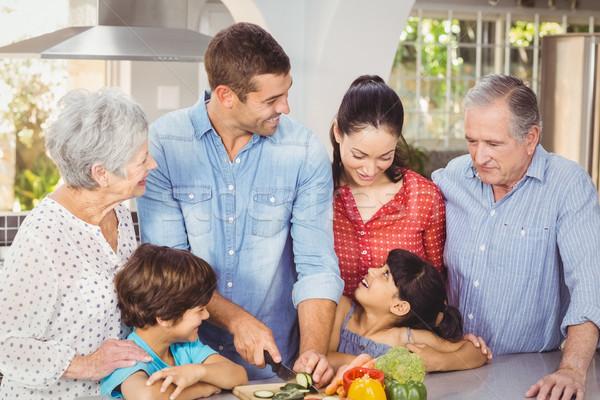 Boldog család ételt készít konyha otthon nő ház Stock fotó © wavebreak_media
