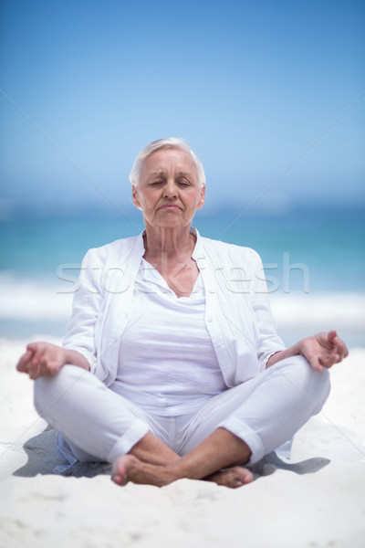 Beautiful mature woman meditating Stock photo © wavebreak_media