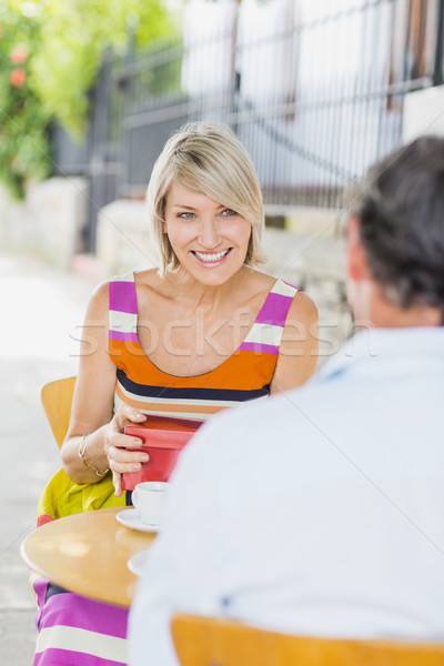 Woman with gift looking at man Stock photo © wavebreak_media