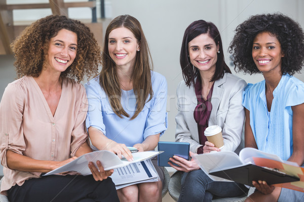 Portrait of female business colleagues sitting together with doc Stock photo © wavebreak_media