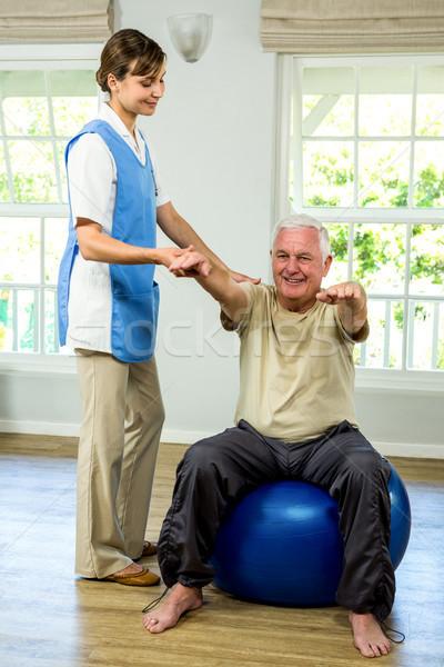 Smiling old man being examined by nurse Stock photo © wavebreak_media