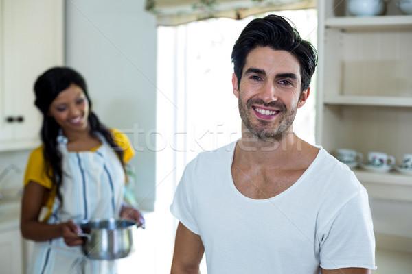 Happy couple preparing food in kitchen Stock photo © wavebreak_media