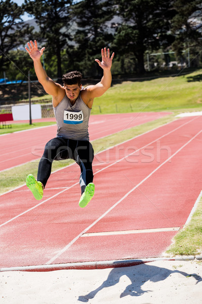 Athlete performing a long jump Stock photo © wavebreak_media