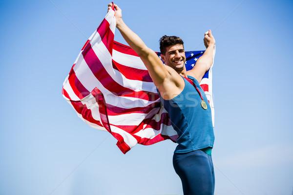 Atléta pózol amerikai zászló arany medálok körül Stock fotó © wavebreak_media