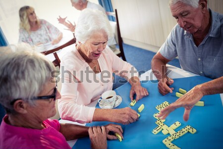 Stock photo: Group of seniors playing cards