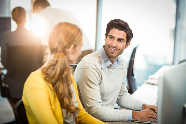 Woman having a discussion with coworker Stock photo © wavebreak_media