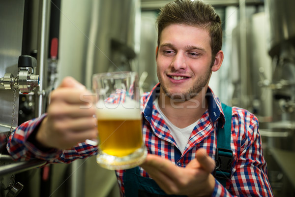 Brewer holding a glass of pint beer Stock photo © wavebreak_media