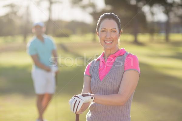 портрет улыбаясь гольфист женщину человека Сток-фото © wavebreak_media