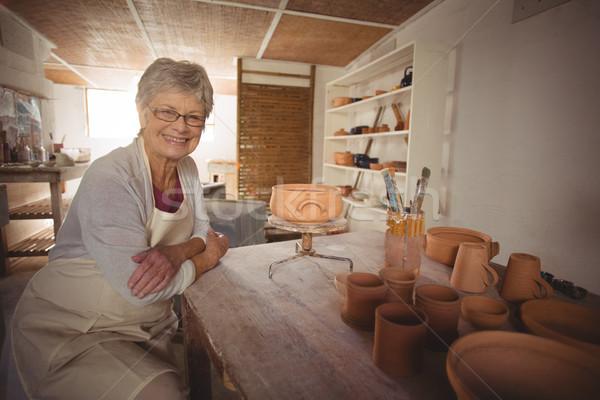 Portrait Homme séance table poterie atelier Photo stock © wavebreak_media