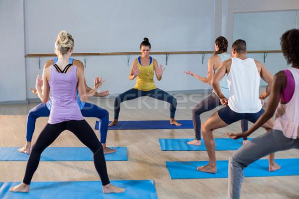 Istruttore yoga classe fitness studio Foto d'archivio © wavebreak_media