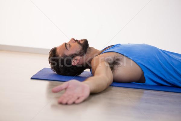 Man in yoga corpse pose Stock photo © wavebreak_media