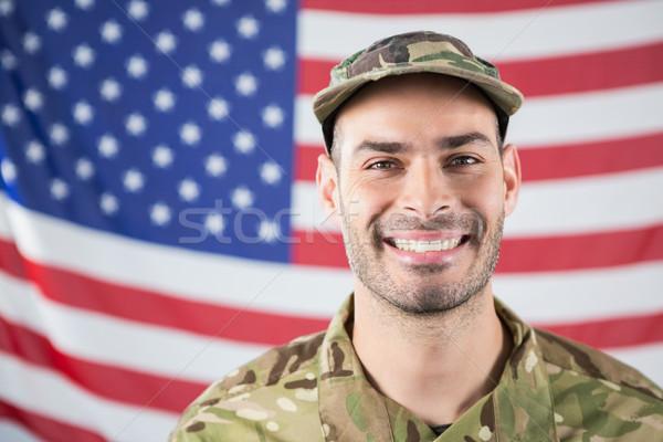 улыбаясь солдата американский флаг человека флаг Сток-фото © wavebreak_media