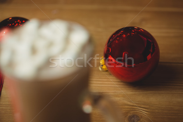 Cup of coffee with marshmallow and christmas bauble Stock photo © wavebreak_media
