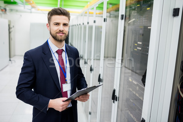 Technician holding a clipboard Stock photo © wavebreak_media
