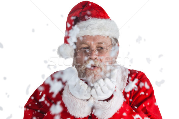 Santa claus blowing fake snow Stock photo © wavebreak_media