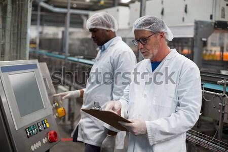 Horologist working on laptop Stock photo © wavebreak_media