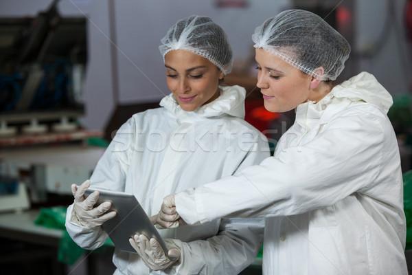 Female butchers discussing over digital tablet Stock photo © wavebreak_media