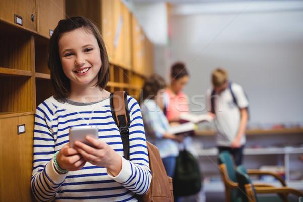 портрет счастливым школьница мобильного телефона раздевалка Сток-фото © wavebreak_media