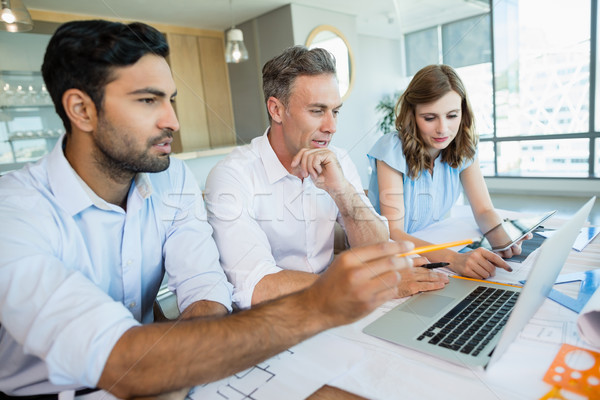 Architects discussing over laptop in conference room Stock photo © wavebreak_media