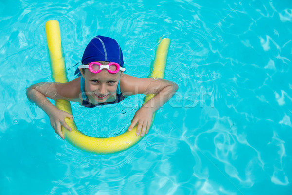 Little girl swimming with pool noodle Stock photo © wavebreak_media
