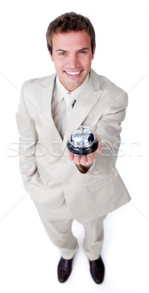 Assertive young businessman holding a service bell  Stock photo © wavebreak_media
