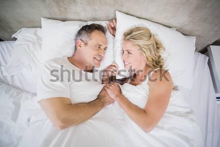 Afetuoso casal cama casa menina Foto stock © wavebreak_media