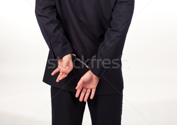 Businessman in hand cuffs Stock photo © wavebreak_media