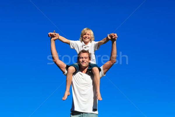 Son sitting on his father's shoulders Stock photo © wavebreak_media