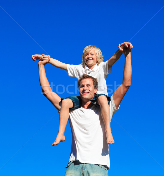 Child sitting on his father's shoulders Stock photo © wavebreak_media