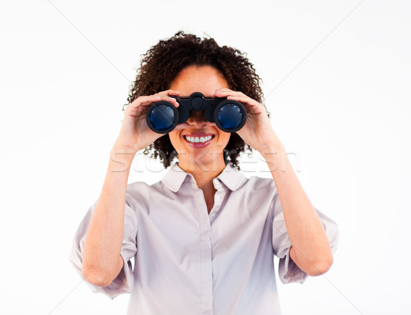 Close-up of smiling businesswoman looking through binoculars Stock photo © wavebreak_media