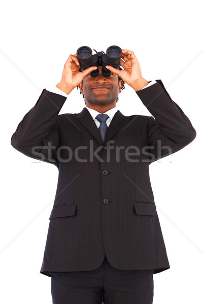 Stock photo: Charming Afro-American businessman with binoculars against a white background