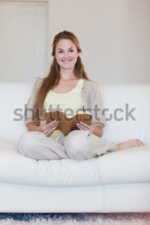 Cute woman doing yoga exercises in the bedroom at home Stock photo © wavebreak_media