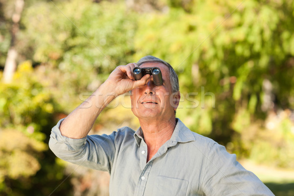 Elderly man looking at the sky with his binoculars Stock photo © wavebreak_media