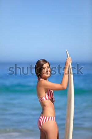 Stock photo: Woman playing frisbee