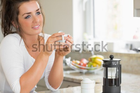 Smiling Woman toasting with wine in a kitchen Stock photo © wavebreak_media