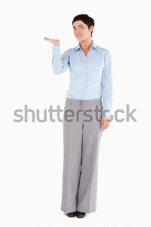 Woman with an open hand to show a copy space against a white background Stock photo © wavebreak_media