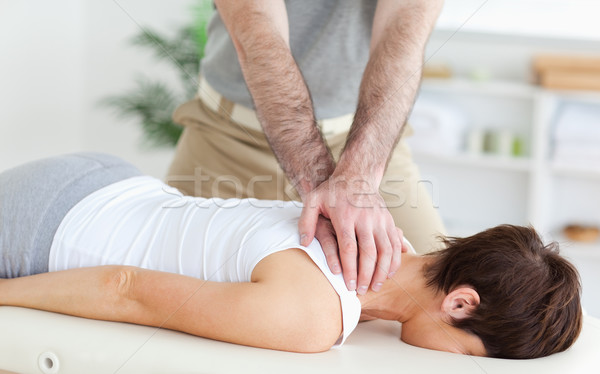 Man massaging a woman in a room Stock photo © wavebreak_media