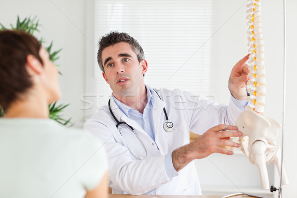 Male Doctor explaining something to a woman in a room Stock photo © wavebreak_media