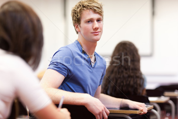 Student sitting at a table in a classroom Stock photo © wavebreak_media