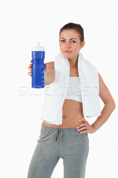 Sporty young woman offering a sip of water against a white background Stock photo © wavebreak_media