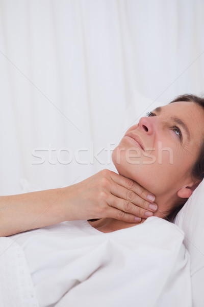 Woman rubbing her aching throat Stock photo © wavebreak_media