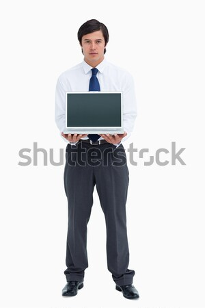 Tradesman presenting screen of his laptop against a white background Stock photo © wavebreak_media