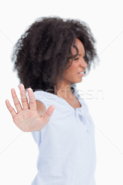 Side view of an angry woman making the hand stop sign against a white background Stock photo © wavebreak_media