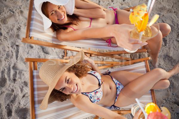 Ver sorridente jovem atraente mulheres exótico Foto stock © wavebreak_media