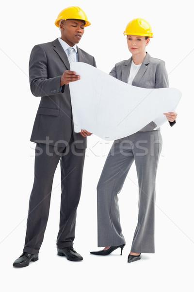 бизнесмен женщину бумаги лист Сток-фото © wavebreak_media