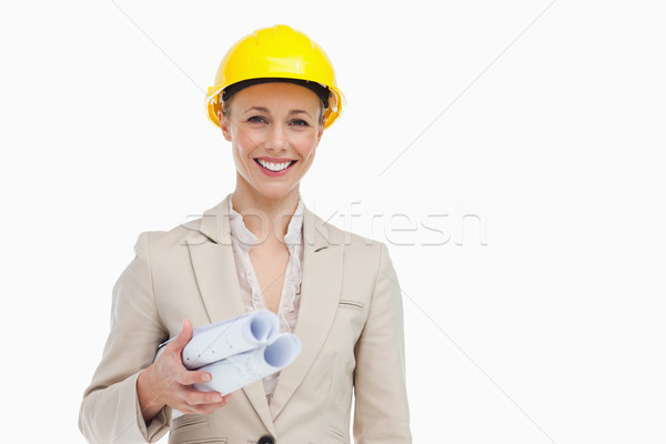 Portrait of a woman architect holding plans against white background Stock photo © wavebreak_media
