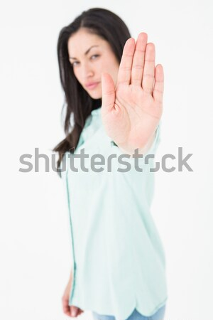 A focus shot of a woman with her hand held out to the camera against a white background Stock photo © wavebreak_media