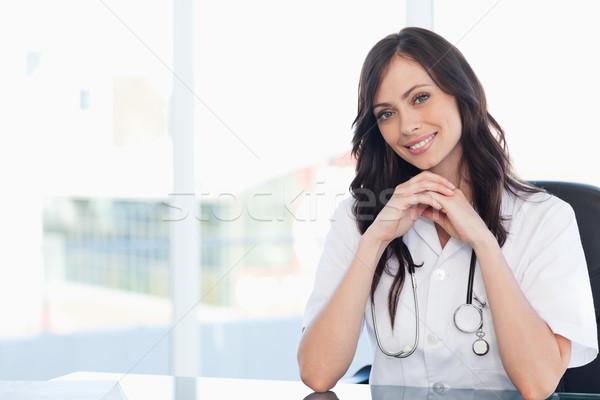 Photo stock: Infirmière · séance · bureau · mains · tête
