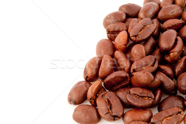 Many dark blurred coffee seeds laid out together against a white background Stock photo © wavebreak_media